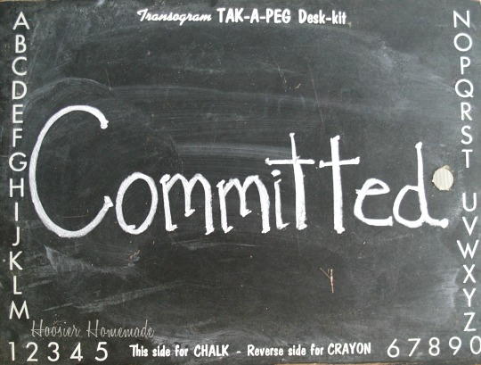 Committed written on blackboard
