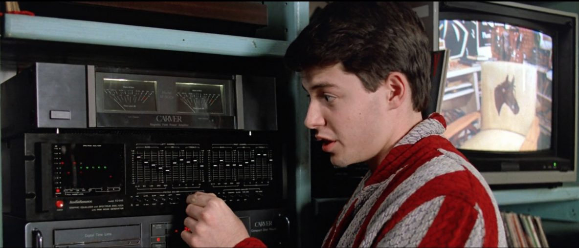 Ferris Bueller standing in front of stereo equalizer